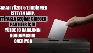 Barajı yüzde 5'e indirmek isteyen MHP, ittifakla seçime girecek partiler için yüzde 10 barajının korunmasını öneriyor
